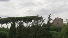Trees and an old building on a cloudy day in Rome - stock footage