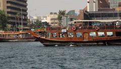 Dubai water tour wood boat sail at creek, tracking shot. Touristic attraction Stock Footage