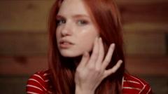 Beautiful redhead girl. Emotions. Stock Footage