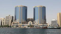 Twin Tower building and shopping complex at Dubai Creek shore, daytime view Stock Footage