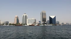 Dubai Creek waterfront buildings and Superyachts berth, wide angle panorama Stock Footage
