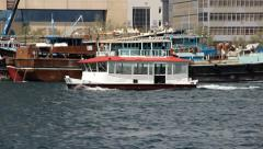 RTA Water bus sail across Dubai Creek, tracking shot. Telephoto view - stock footage