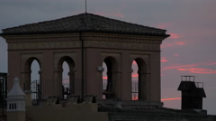 Latin inscription seen on the top of a building at sunset in Rome - stock footage