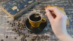 Female hand stirs sugar in coffee Stock Footage