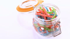Candies in candy jar on a white background. Stock Footage