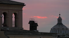 Gorgeous view of the dome of a church and tower of a building at sunset in Rome - stock footage