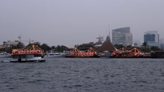 Three dhow boats, floating restaurants, stay at berth, Bur Dubai shore of creek Stock Footage