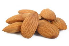 Almond nuts isolated on white background Stock Photos