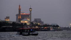 Dubai Creek at late evening, Bur Dubai Grand Masjid and Farooq Mosque minaret Stock Footage