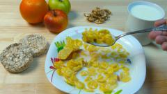Hand mixing flakes in a bowl. Healthy breakfast - stock footage