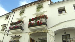Spanish House with Flowers on Balconies Stock Footage