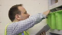Warehouse employee checks stock Stock Footage
