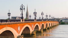 Sunset over the old bridge in Bordeaux city Stock Footage