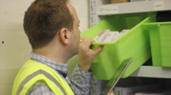 Stock check in warehouse with iPad Stock Footage