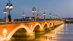 Old bridge in Bordeaux city at sunset time Stock Footage