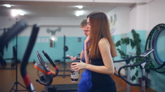 Stock Video Footage of girl athlete drinking water get tired in gym trainers sport