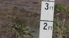 4K Measuring Rainfall Inches Feet Stock Footage