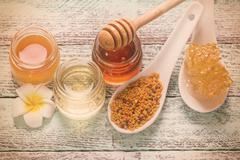 healthy honey composition, wooden background, vintage filters - stock photo