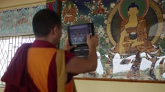 Happy Buddhist Monk taking ipad photo Stock Footage