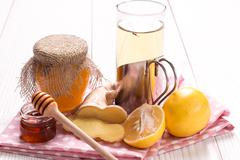 Tea,honey, lemon and ginger on wooden table.healthy food. - stock photo