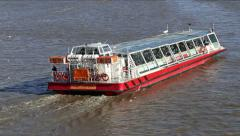 Illustrative touristic. A touristic boat sails in the river Thames. Stock Footage