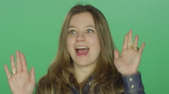 Young woman dancing and making funny faces, on a green screen background - stock footage