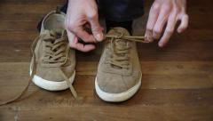 Hands Putting Shoes And Tying Laces Stock Footage