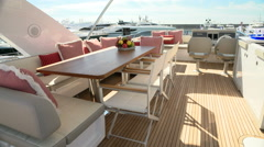 Upper deck of a luxury yacht docked during Genoa Boat Show Stock Footage