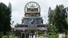 Crowd of people going to Big Buddhist monastery Stock Footage