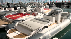 Fast rubber boats docked during Genoa Boat Show Stock Footage