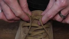Man's Hands Tie Laces On Shoe Stock Footage