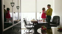 4 Business Manager Woman Playing With Daughter In Office Stock Footage