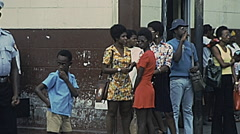 Grenada 1976: people waiting in the street Stock Footage