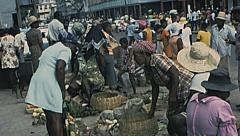 St Lucia 1976: people in an outdoor market Stock Footage