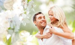 Happy couple over cherry blossoms background Stock Photos