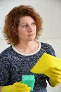 Woman thinks about the upcoming cleaning in  house Stock Photos