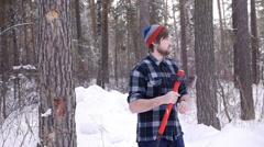 Lumberjack standing with his ax in the woods, light leakage surround him - stock footage