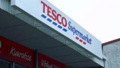 Slowmotion view of the main entrance to the supermarket Tesco in Kunratice Stock Footage
