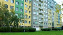 Slowmotion view on the leaves in grass in front of block of flats Stock Footage