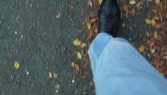Slowmotion view on someone´s legs which walks along the way  Stock Footage