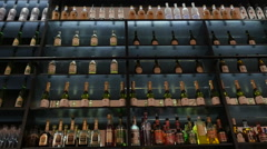 Liquor Bottles On Bar Shelf Stock Footage