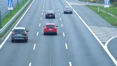 Slowmotion view close-up on the cars that go on three-lane the highway Stock Footage