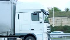 Slowmotion detail view on truck goes on highway  Stock Footage
