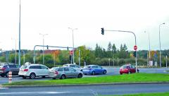 Slowmotion cars start on traffic light on crossroad Stock Footage