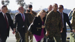 Ash Carter walking with Marines and others - stock footage
