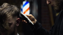 Barber cuts the hair of the client with clipper slow motion close up - stock footage