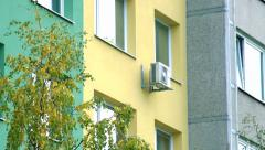 Slowmotion view on block of flats with windows and  air-conditioner Stock Footage