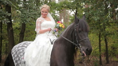 bride posing on the brown horse and fears - stock footage