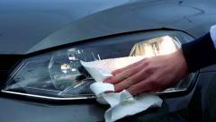 Slowmotion somebody cleans headlights of car Stock Footage
