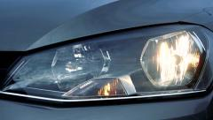 Slowmotion view on switches on sidelights and daylight of car Stock Footage